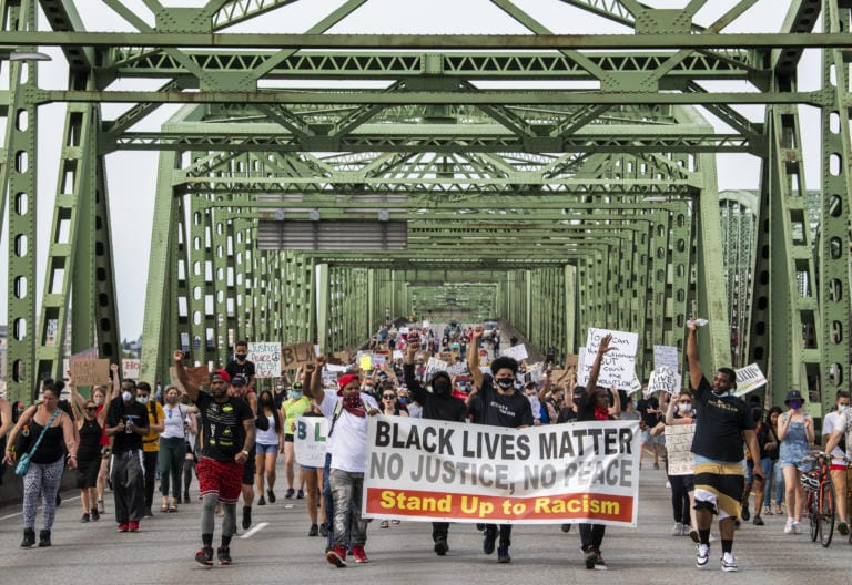 LEAD OPTION: Hundreds of demonstrators, led by founders of M.A.D PDX, marched from Esther Short Park across Interstate 5 to commemorate Juneteenth and rally together for Black lives Friday afternoon, June 19, 2020. Friday marked Juneteenth, the oldest holiday that commemorates the ending of slavery in the United States 155 years ago. Amid the upraising following the killing of George Floyd in police custody, this day is now being acknowledged as a holiday by corporations and state governments across the country. (Alisha Jucevic/The Columbian)