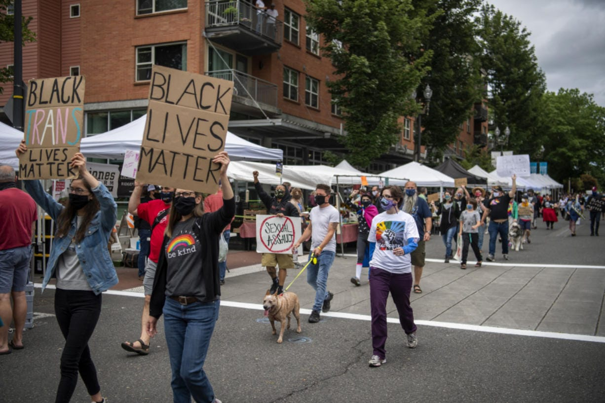 About a hundred community members march through the Vancouver Farmers Market to advocate and celebrate the Black queer and transgender community. Southwest Washington Communities United for Change founder and President Lexi Bongiorno said she wanted to create an opportunity for the community to celebrate Pride but also stay aligned and honor the Black Lives Matter movement.