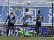 Portland Thorns FC goalkeeper Bella Bixby looks on as North Carolina Courage forward Lynn Williams (9) scores against her during the second half of an NWSL Challenge Cup soccer match at Zions Bank Stadium Saturday, June 27, 2020, in Herriman, Utah.