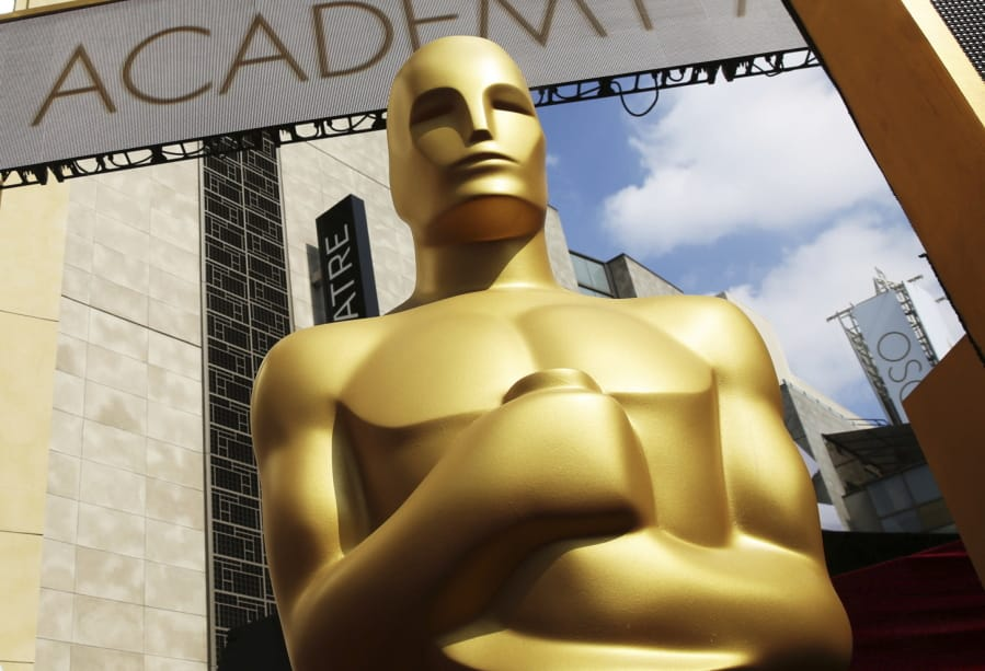 FILE - In this Feb. 21, 2015 file photo, an Oscar statue appears outside the Dolby Theatre for the 87th Academy Awards in Los Angeles. The Oscars are implementing some big changes, including having a set number of best picture nominees and to-be-determined representation and inclusion standards for eligibility. The Academy of Motion Picture Arts and Sciences says Friday that there will be 10 best picture nominees beginning with the 94th Academy Awards in 2022.