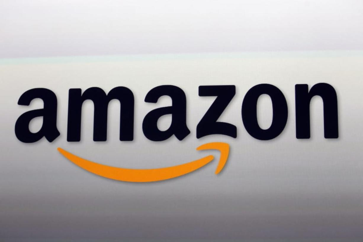 FILE - This Sept. 6, 2012, file photo shows the Amazon logo in Santa Monica, Calif. Amazon said Wednesday, June 10, 2020, that it will pause police use of its facial recognition technology for a year. The Seattle-based company did not say why it was doing so, but protests after the death of George Floyd have focused attention on racial injustice in the U.S. and how police use technology to track people.
