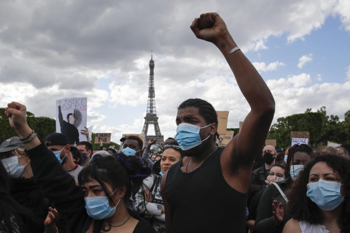 Hundreds of demonstrators gather on the Champs de Mars as the Eiffel Tower is seen in the background during a demonstration in Paris, France, Saturday, June 6, 2020, to protest against the recent killing of George Floyd, a black man who died in police custody in Minneapolis, U.S.A., after being restrained by police officers on May 25, 2020.