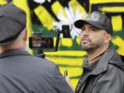 Joey Gibson, right, founder of the far-right group Patriot Prayer, takes part in a livestream video broadcast, inside what has been named the Capitol Hill Occupied Protest zone in Seattle, Monday, June 15, 2020.  (AP Photo/Ted S.