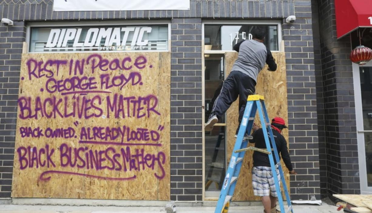 Diplomatic 1750, a sneaker and streetwear consignment boutique owned by Brian Heath, is boarded up in Chicago on June 1, 2020. Heath, who is black, said he's upset that his sneaker and streetwear consignment boutique in Chicago's Wicker Park neighborhood was vandalized on Sunday. But he's even more upset about Floyd's death, which triggered the unrest.