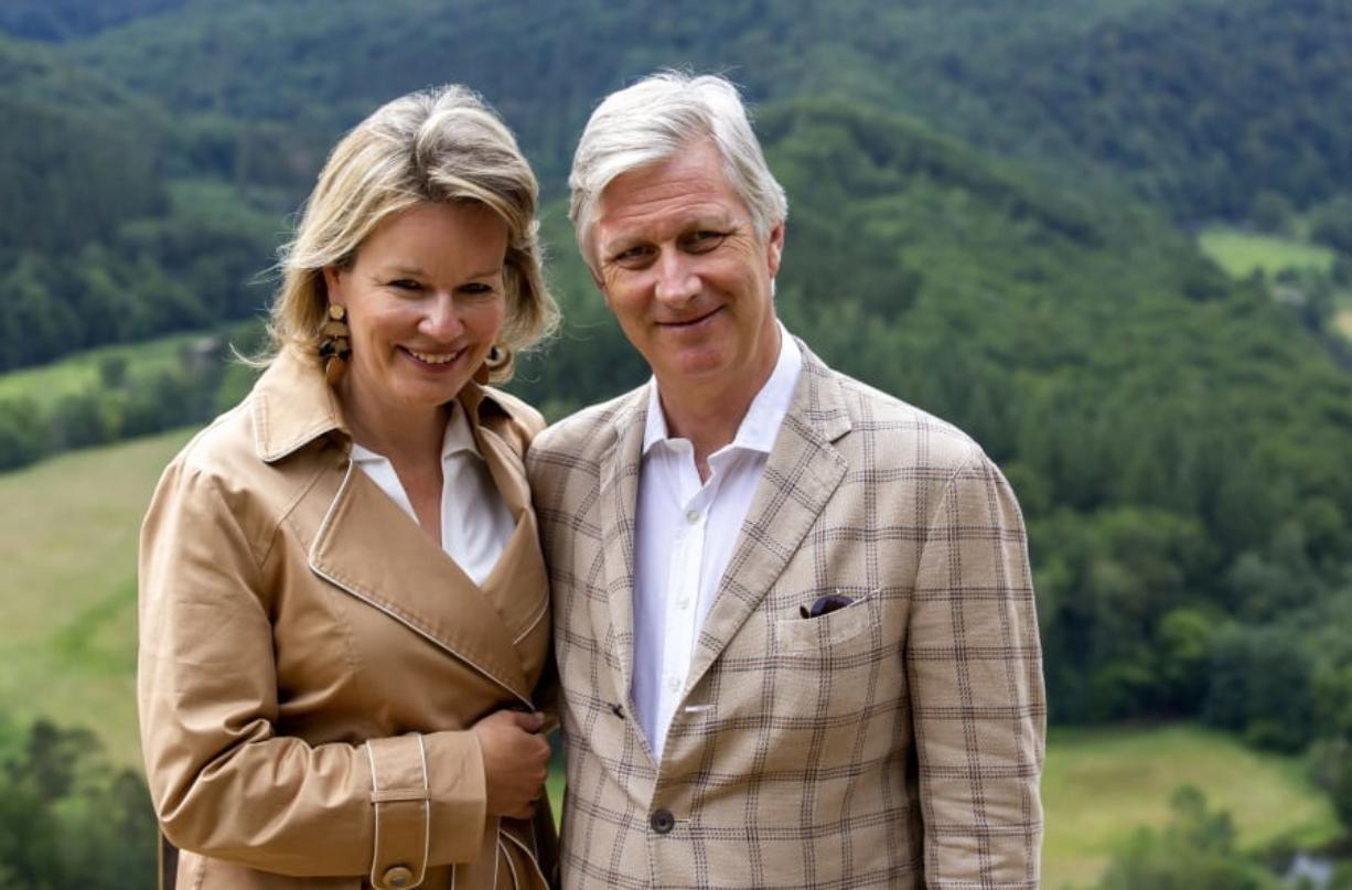 Belgium's King Philippe and Queen Mathilde pose for a photographer during a royal visit to the Giant's Tomb in Bouillon, Belgium, Sunday, June 28, 2020.