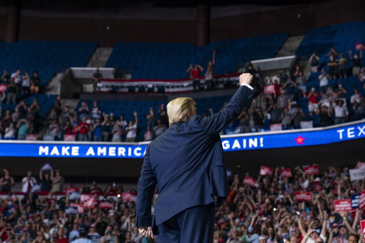 President Donald Trump arrives on stage to speak at a campaign rally at the BOK Center, Saturday, June 20, 2020, in Tulsa, Okla.