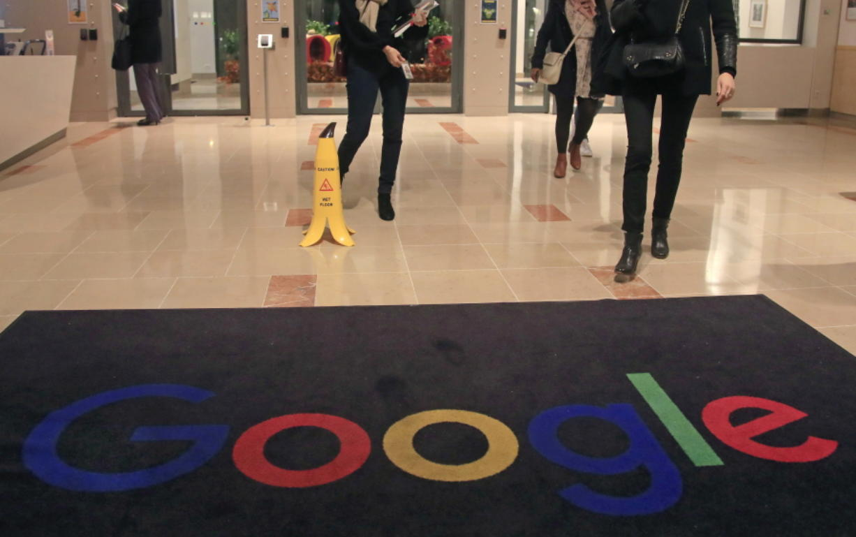 FILE - In this file photo dated Nov. 18, 2019, Google employees walks out of Google France building in Paris. France.  France'Aos highest administrative court on Friday June 19, 2020, has upheld a fine of 50 million euros (dollars 56 million US) against Google for not being 'Ausufficiently clear and transparent'Au with users of Android about their data protection options.