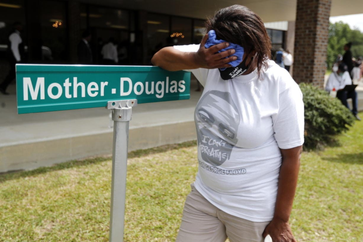 A mourner is overcome with grief after viewing the body of George Floyd during his memorial service, Saturday, June 6, 2020, in Raeford, N.C. George Floyd's death and the protests it ignited nationwide over racial injustice and police brutality have raised questions about whether Arradondo -- or any chief -- can fix a department that's now facing a civil rights investigation.