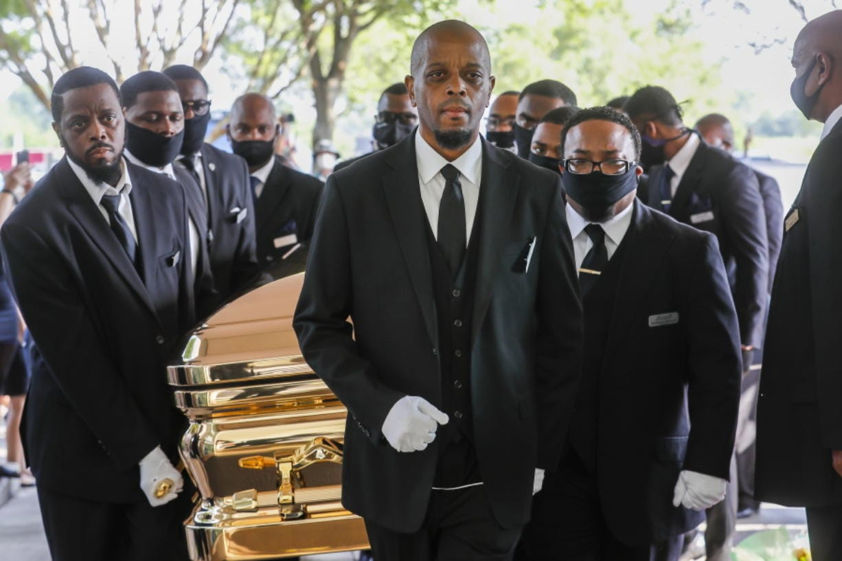 Pallbearers bring the coffin into The Fountain of Praise church in Houston for the funeral for George Floyd on Tuesday, June 9, 2020. Floyd died after being restrained by Minneapolis Police officers on May 25. (Godofredo A.
