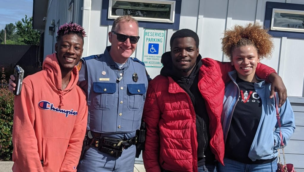 From left, Izac Robinson, Woodland Mayor and Washington Patrol Trooper Will Finn, Nehemiah Polk-Rasheed and Aaliyah Guard. The group, minus Finn, and their friend Sameayah Pehlke were chased by a white man with a gun from a beach in Kalama on Wednesday. Cowlitz County sheriff's deputies have arrested Dean A. Schrader, 76, of Kalama in relation to the incident. Finn was not involved in investigating the incident in Kalama.