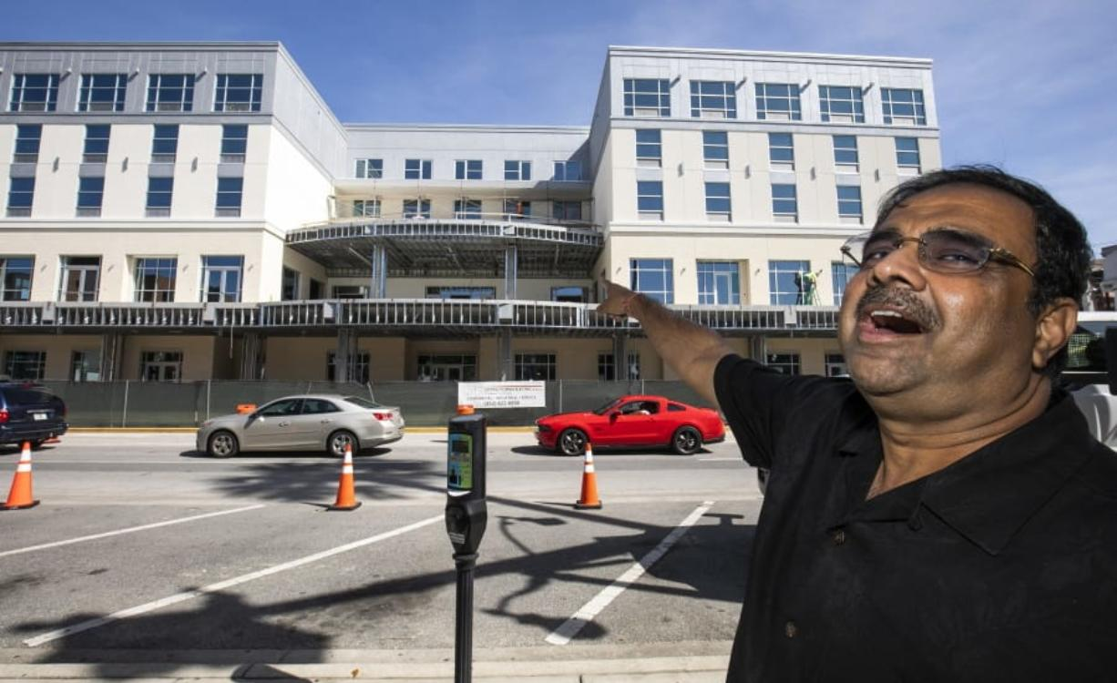 FILE - In this Oct. 23, 2019 file photo, developer Danny Gaekwad talks about the roof top bar on his Hilton Garden Inn hotel that is presently under construction  in Ocala, Fla.  Since the coronavirus crisis started, hotel owners say they are struggling to get relief on a type of loan that Wall Street investors buy.
