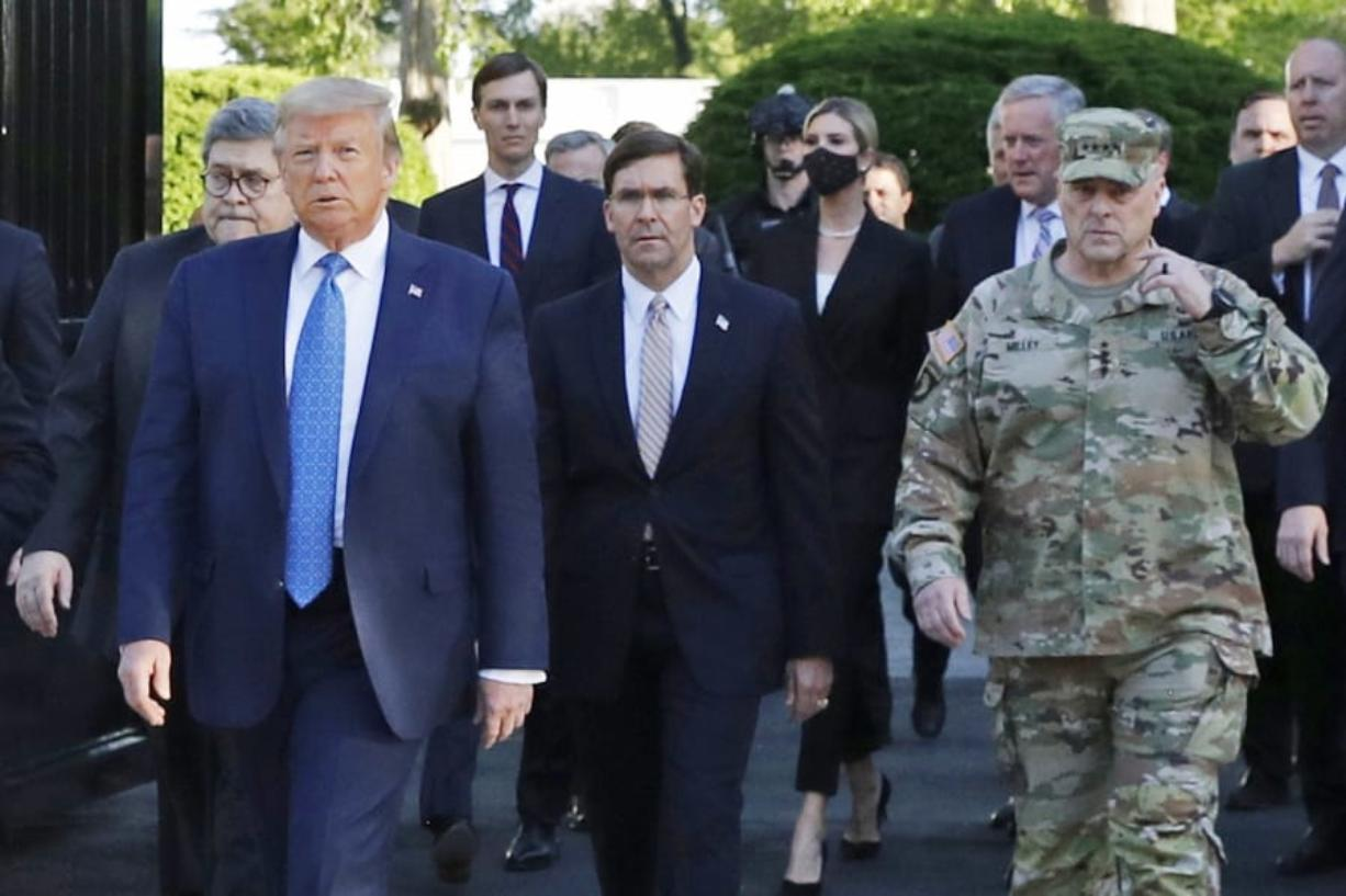 FILE - In this June 1, 2020 file photo, President Donald Trump departs the White House to visit outside St. John's Church, in Washington. Walking behind Trump from left are, Attorney General William Barr, Secretary of Defense Mark Esper and Gen. Mark Milley, chairman of the Joint Chiefs of Staff.
