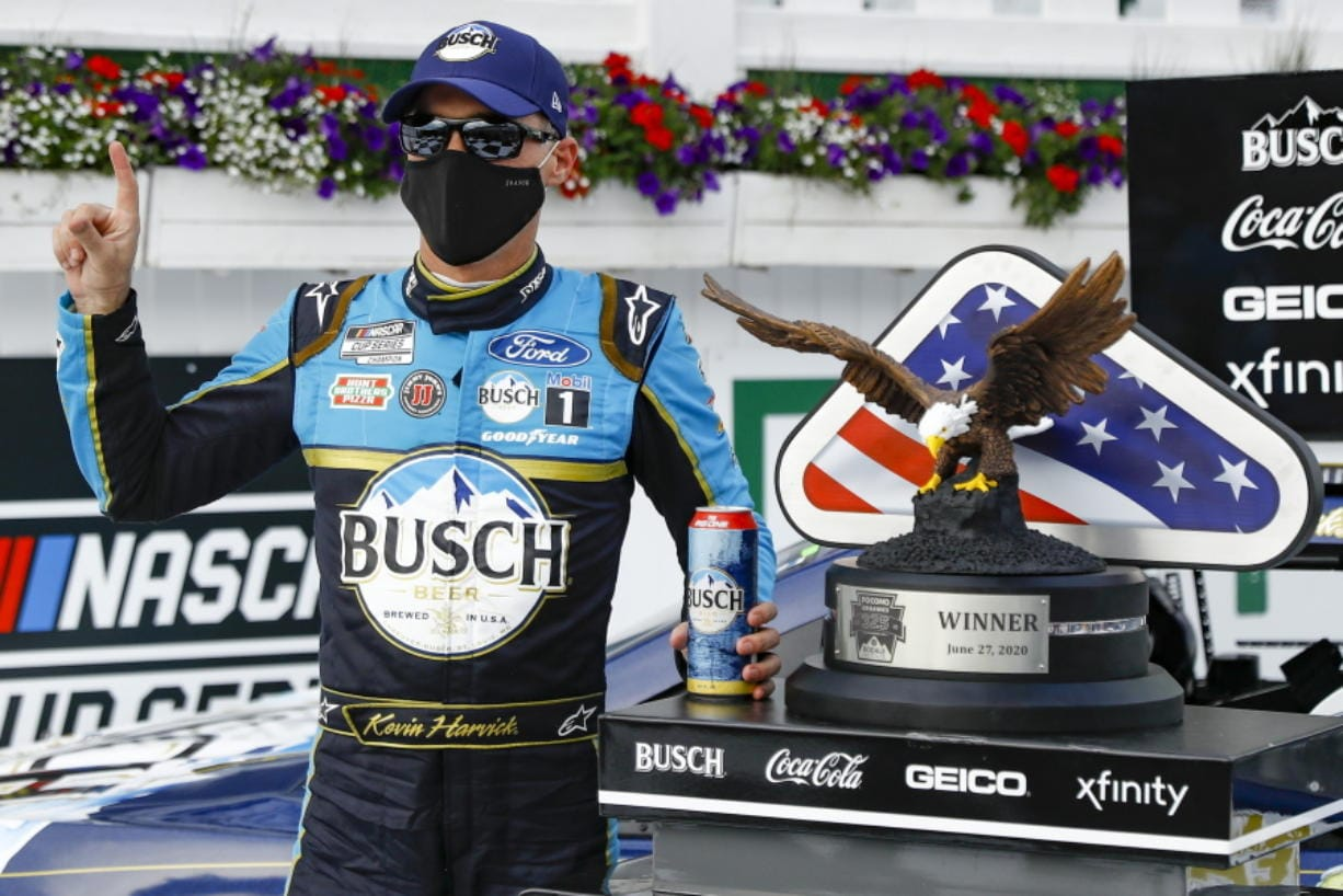 Kevin Harvick celebrates in the winners circle after winning the NASCAR Cup Series auto race at Pocono Raceway, Saturday, June 27, 2020, in Long Pond, Pa.