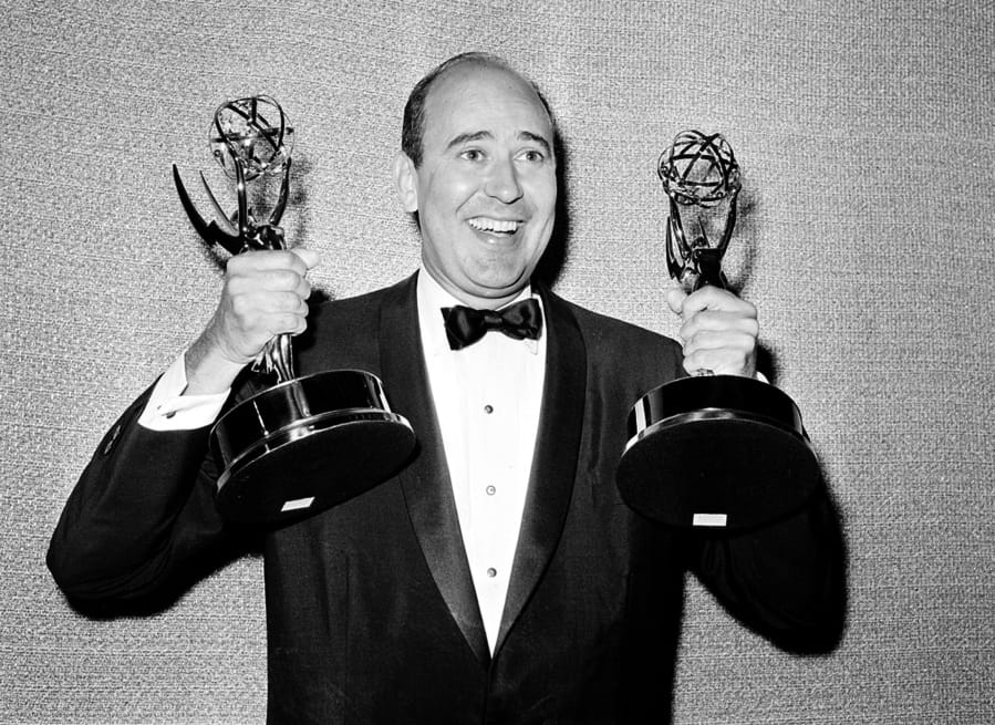 """FILE - In this May 26, 1963 file photo, Carl Reiner shows holds two Emmy statuettes presented to him as best comedy writer for the """"Dick Van Dyke Show,"""" during the annual Emmy Awards presentation in Los Angeles. Reiner, the ingenious and versatile writer, actor and director who broke through as a """"second banana"""" to Sid Caesar and rose to comedy's front ranks as creator of """"The Dick Van Dyke Show"""" and straight man to Mel Brooks' """"2000 Year Old Man,"""" has died, according to reports. Variety reported he died of natural causes on Monday night, June 29, 2020, at his home in Beverly Hills, Calif. He was 98."""