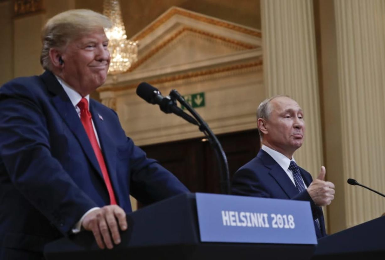 FILE - In this July 16, 2018, file photo Russian President Vladimir Putin, right, and U.S. President Donald Trump give a joint news conference at the Presidential Palace in Helsinki, Finland. For the past three years, the administration has careered between President Donald Trump's attempts to curry favor and friendship with Vladimir Putin and longstanding deep-seated concerns about Putin's intentions.