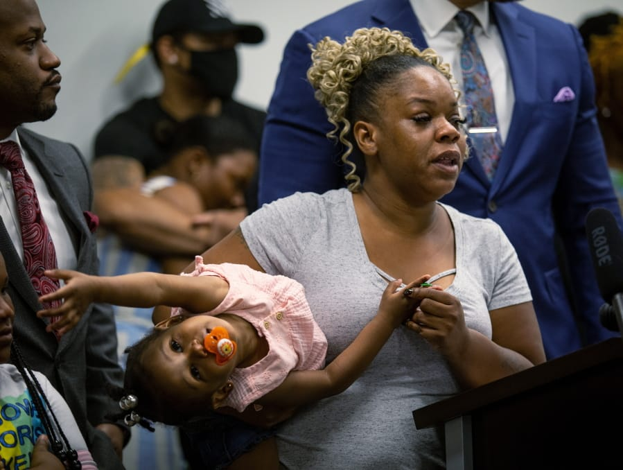 Tomika Miller, the widow of Rayshard Brooks, speaks at a news conference on Monday, June 15, 2020, in Atlanta. The Brooks family and their attorneys spoke to the press just days after Rayshard Brooks was shot and killed by police at a Wendy's restaurant parking lot in Atlanta. The family wants the officers involved in Brooks' death arrested and prosecuted.