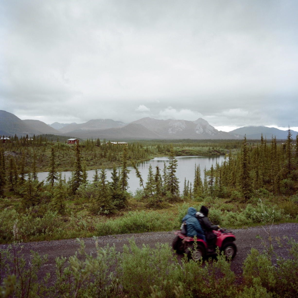 In this June 14, 2019 photo, a four-wheeler is ridden through Arctic Village, Alaska. If the pandemic has deepened the sense of isolation for the 8,000 or so Gwich'in, sprinkled across northeastern Alaska into Canada, it has also emphasized the importance of the tribe's traditions and its profound spiritual connection to the homelands that sustain the caribou and other wildlife on which they depend.