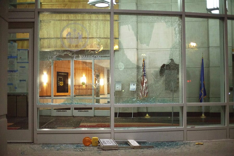 The windows of the Tommy G. Thompson Center on Public Leadership in Madison, Wis. are shattered during demonstrations Tuesday, June 23, 2020.  Crowds outside the Wisconsin State Capitol tore down two statues and attacked a state senator amid protests following the arrest of a Black man who shouted at restaurant customers through a megaphone while carrying a baseball bat.