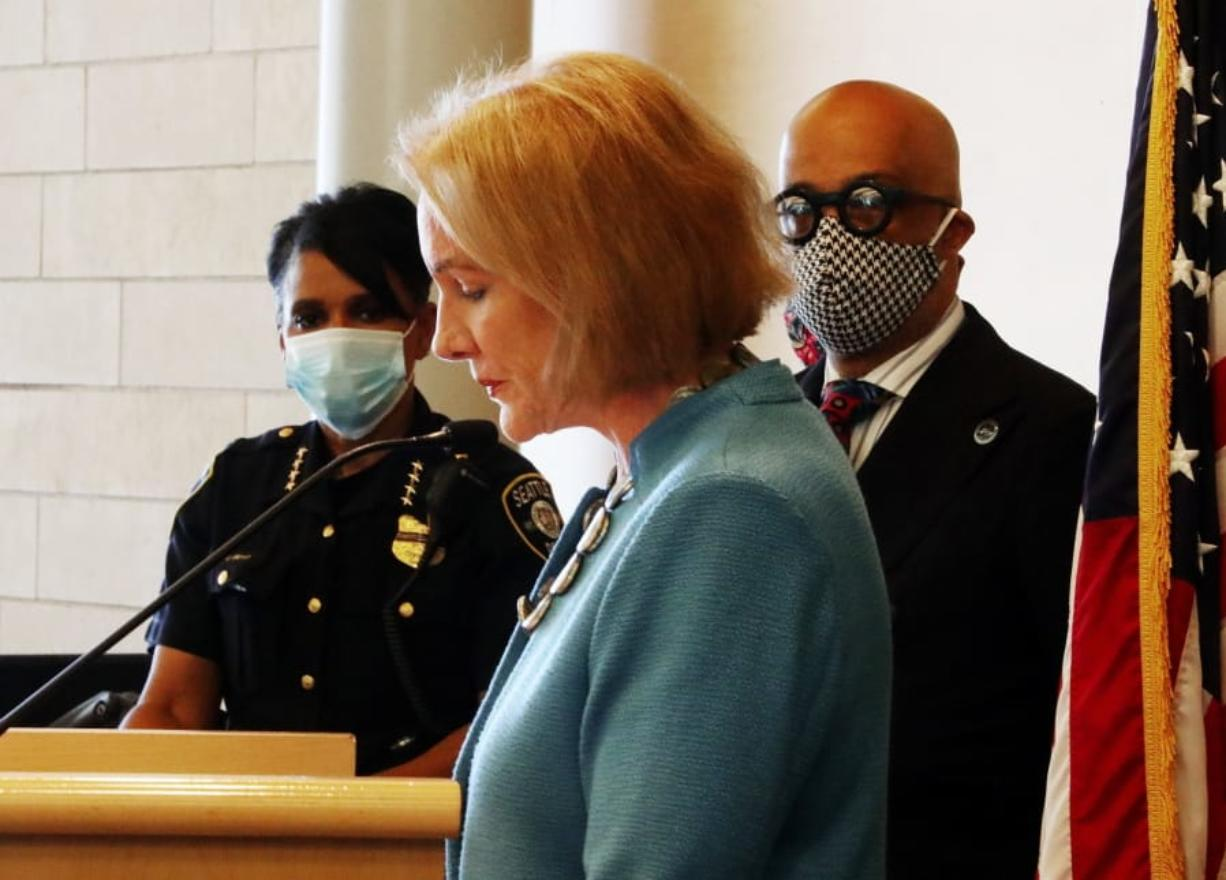 "Seattle Mayor Jenny Durkan, center, pauses while speaking, as Chief of Police Carmen Best, left, listens during a news conference Monday, June 22, 2020, in Seattle. Durkan said the city is working with the community to bring the  ""Capitol Hill Occupied Protest"" zone to an end."