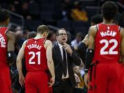 Toronto coach Nick Nurse, center, and the Raptors have an NBA championship to defend, a very long stay at the Disney complex awaiting them and plenty of unanswered questions on how the restart of the season will work.