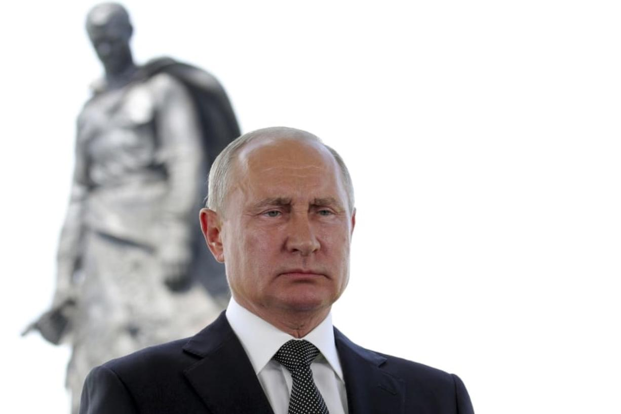 Russian President Vladimir Putin appears in a televised address to the nation in Khoroshevo, the Tver region, with a monument to World War II Red Army soldiers seen in the background, Russia, Tuesday, June 30, 2020. Putin urged voters to cast ballots in a constitutional vote wrapping up Wednesday that could allow him to extend his rule until 2036.