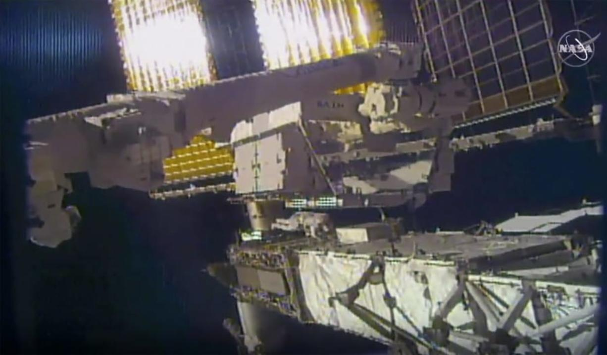 This photo provided by NASA shows NASA astronaut Chris Cassidy and NASA Flight Engineer Bob Behnken during a spacewalk outside the International Space Station on Friday, June 26, 2020.  Cassidy and Behnken, are conducting the first of at least four spacewalks to replace the last bunch of old station batteries.