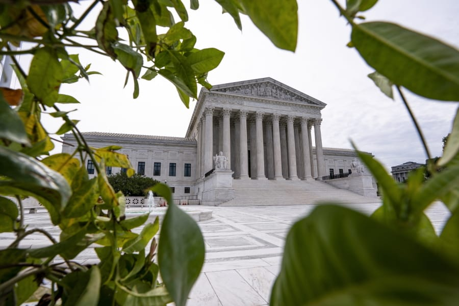 The Supreme Court is seen in Washington, early Monday, June 15, 2020. (AP Photo/J.