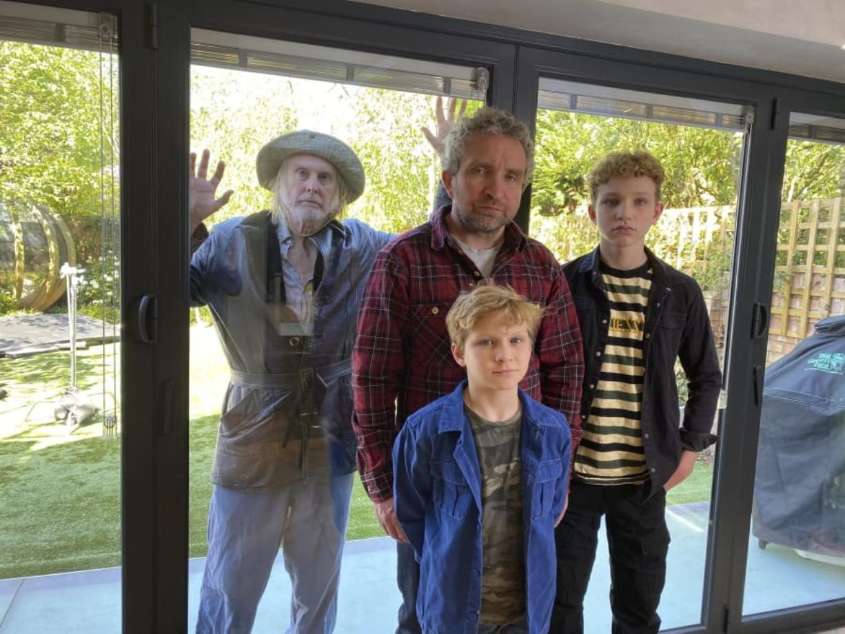 """David Threlfall, from left, Eddie Marsan and his sons Blu Marsan, foreground center, and Bodhi Marsan appear in """"Isolation Stories,"""" a series of four short dramas depicting life in lockdown, produced by Oscar nominated writer and producer Jeff Pope."""
