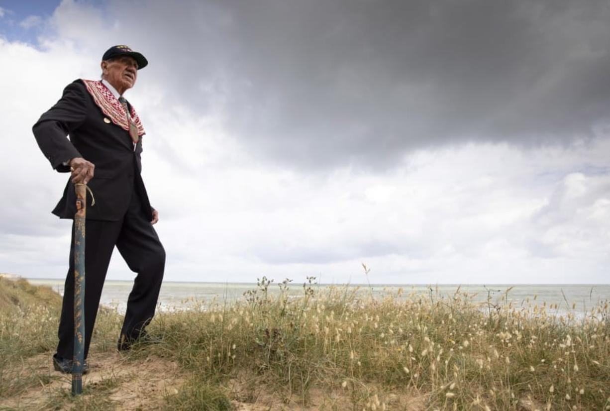 World War II D-Day veteran and Penobscot Elder from Maine, Charles Norman Shay poses on the dune overlooking Omaha Beach prior to a ceremony at his memorial in Saint-Laurent-sur-Mer, Normandy, France, Friday, June 5, 2020. Saturday's anniversary of D-Day will be one of the loneliest remembrances ever, as the coronavirus pandemic is keeping almost everyone away, from government leaders to frail veterans who might not get another chance for a final farewell to their unlucky comrades.