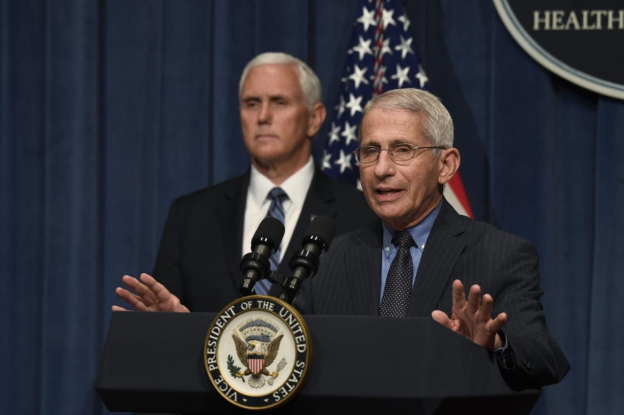Dr. Anthony Fauci, right, director of the National Institute of Allergy and Infectious Diseases, speaks during a briefing with members of the Coronavirus Task Force, including Vice President Mike Pence, left, at the Department of Health and Human Services in Washington, Friday, June 26, 2020.
