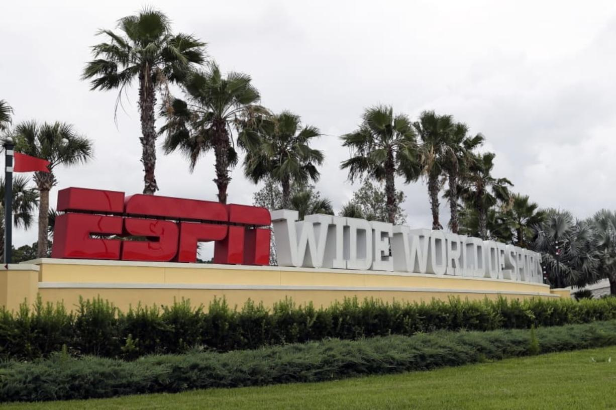 A sign marking the entrance to ESPN's Wide World of Sports at Walt Disney World is seen Wednesday, June 3, 2020, in Kissimmee, Fla. The NBA has told the National Basketball Players Association that it will present a 22-team plan for restarting the season at Disney.