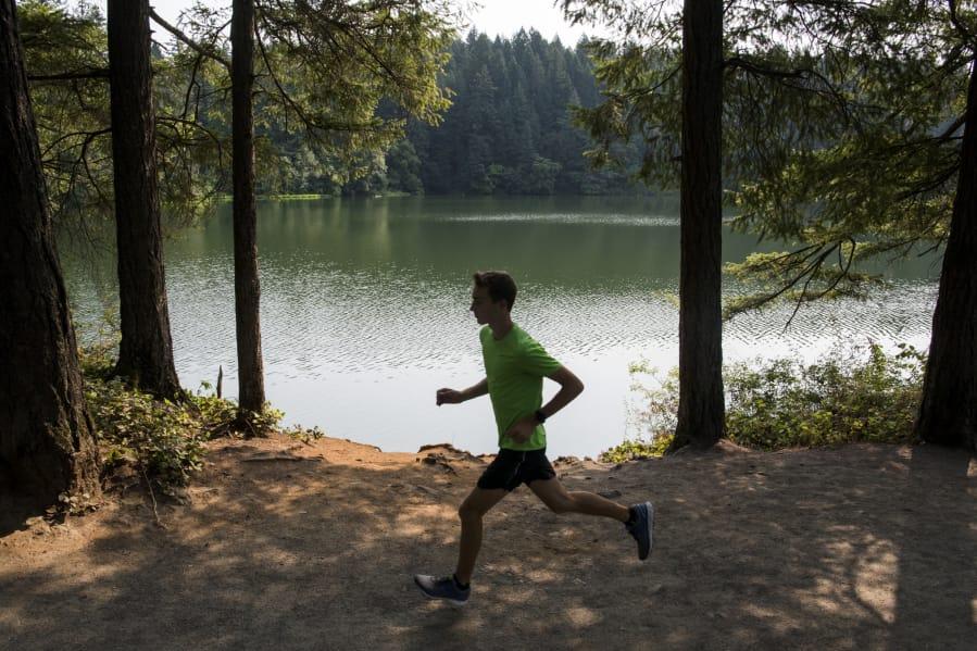 Gabe Dinnel runs near Round Lake in Camas.