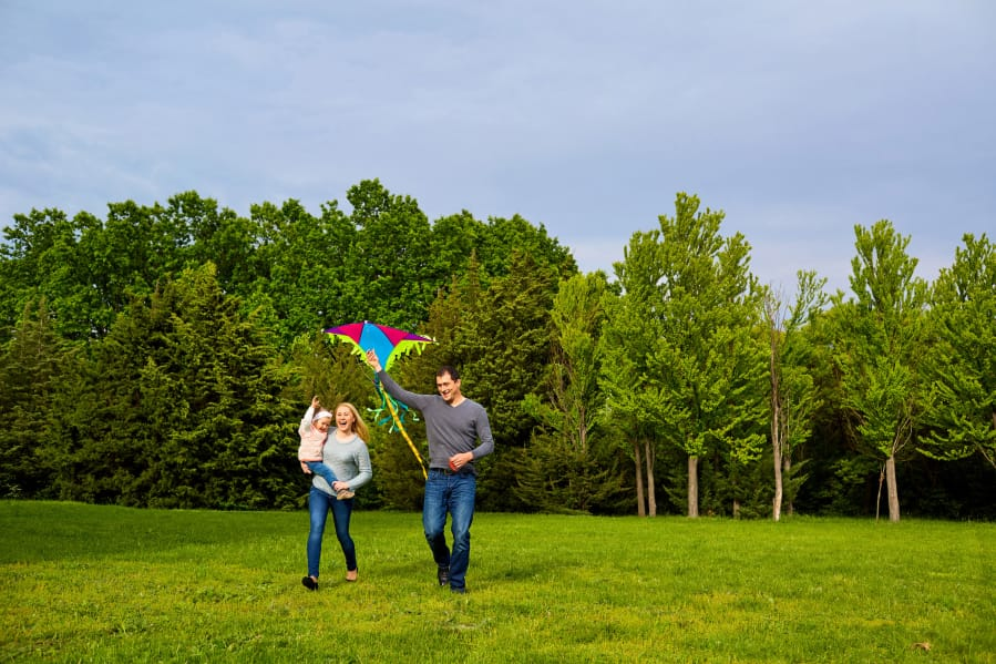 An ideal place to set a kite aloft is a wide open park field without many people or trees around.