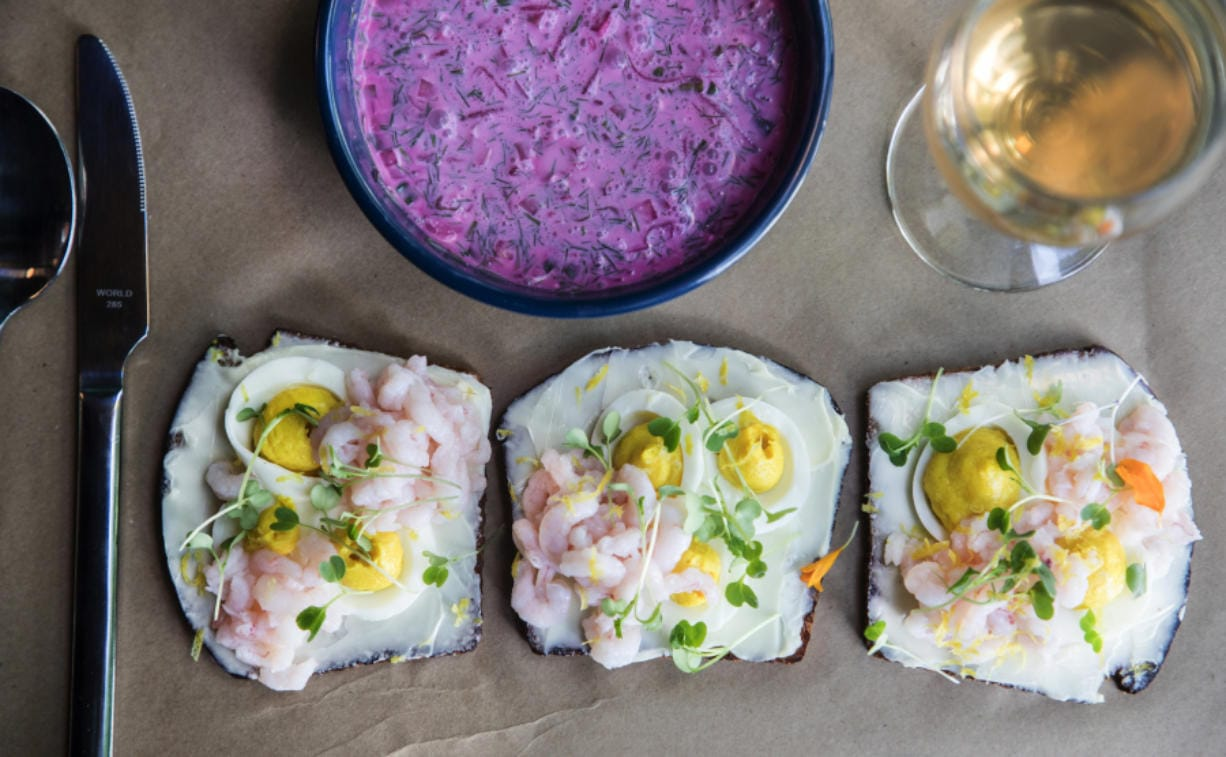 Window light illuminates the cocktail shrimp open-faced sandwiches that are popular along with chlodnik, chilled beet soup with kefir.
