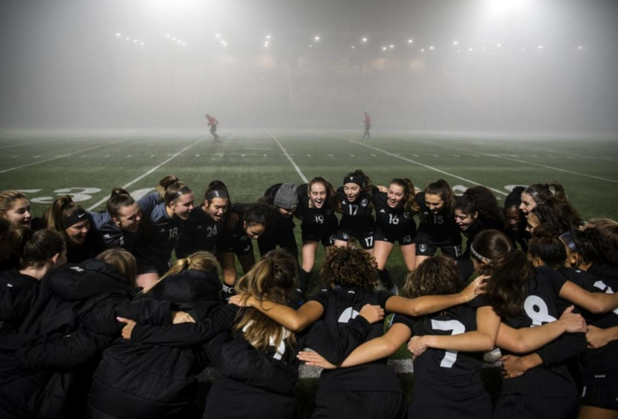 Members of the Union girls team huddle together for a cheer beforeround one of the 4A state soccer playoffs at McKenzie Stadium in Vancouver last season.