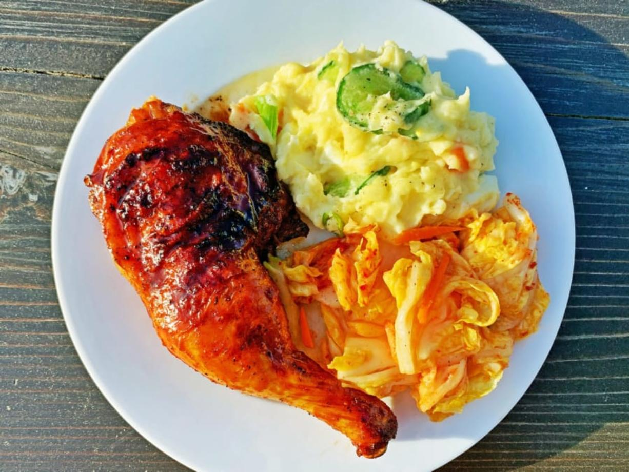 """Gochujang-glazed chicken on the grill."""" and the other is """"Gochujang-glazed grilled chicken with potato salad and kimchi."""