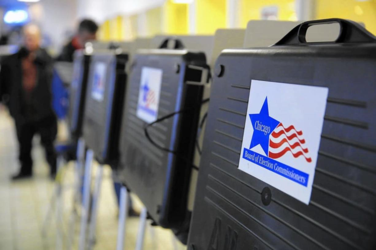 A row of voting booths in Chicago's Irving Park neighborhood on February 24, 2015. (Jose M.