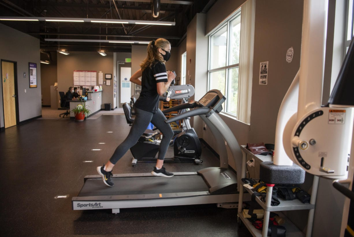 Columbia River graduate Jordan Ryan warms up during physical therapy at ProActive fitness in Vancouver on June 30, 2020. Ryan tore her ACL in March and has been working on physical therapy since her surgery to bring her back to full health.
