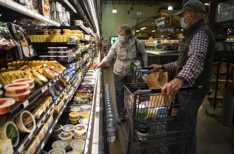 Gail Gehrke, left, and her husband Richard, both of Vancouver, shop together in summer 2020 at Chuck's Produce in Salmon Creek.