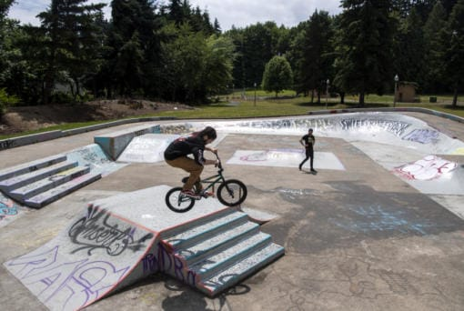 Joseph Moneybrake, left, and Daemion Speckman, both of Portland, bike at Swift Skate Park on Friday. The park reopened on Tuesday. Moneybrake said they noticed many of the skate parks in Portland are still closed, and they wanted to try out a new park.