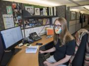 """Madison Riethman, a communicable disease epidemiologist for Clark County Public Health, is pictured at work. She said the pandemic has raised awareness about her profession. """"What's interesting about COVID-19 is that it has raised the awareness of epidemiology,"""" Riethman said."""