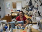 """Grace Anderson, a tailor in Battle Ground, wishes more people would sew. """"I don't know if they have the patience for it. I've been trying to encourage my granddaughter to start sewing. She has a machine. But she's like 'Ah, I don't know.' They have other priorities,"""" she said."""