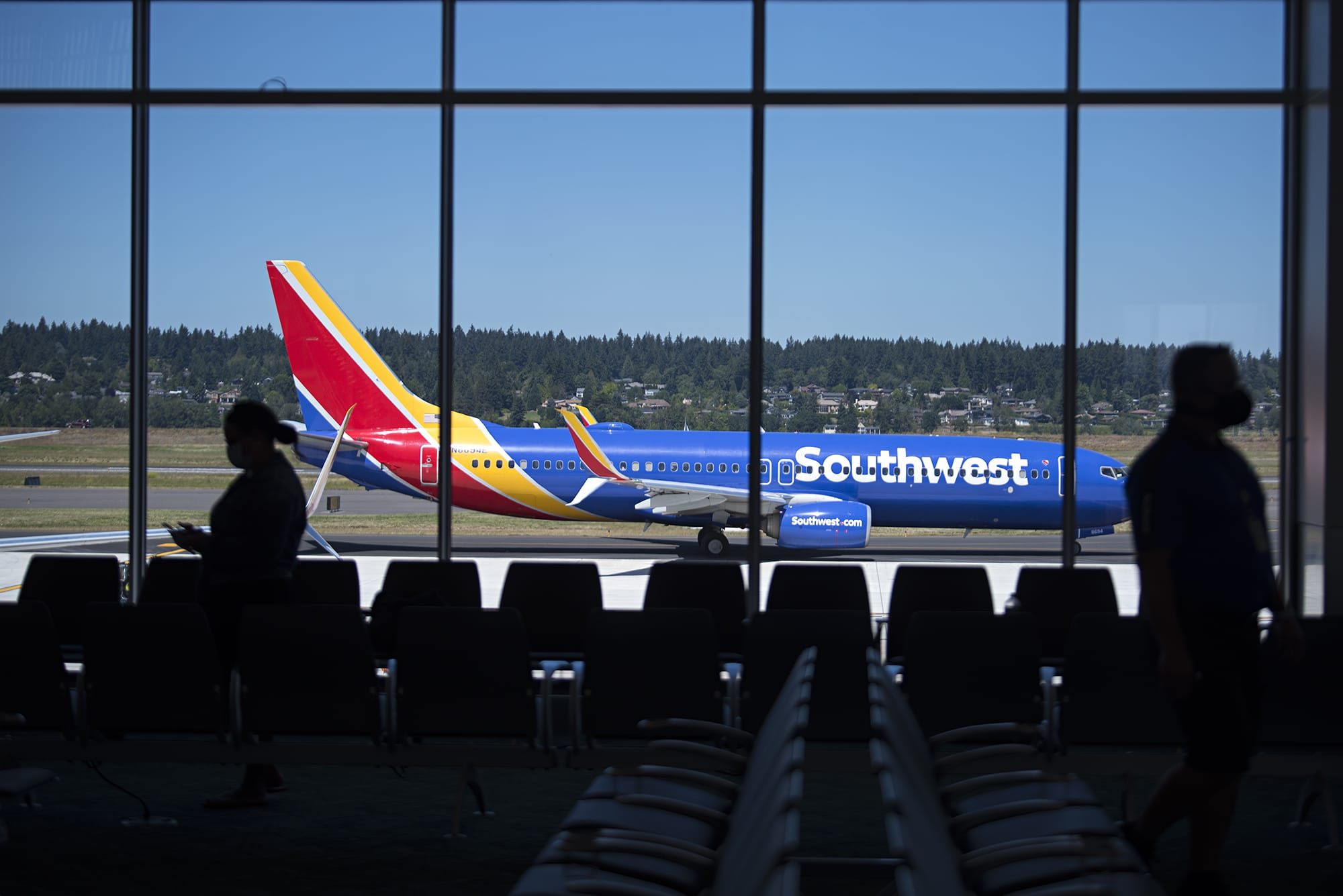 Travelers at gate E10 wait to board a Southwest plane in the new concourse E extension at Portland International Airport on Wednesday afternoon, July 15, 2020. The new section is now the home for Southwest Airlines. (Amanda Cowan/The Columbian)