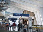 High ceilings and distinctive artwork by Jacob Hashimoto are just a couple of the features of the new section of Concourse E at Portland International Airport, which opened for travel on Wednesday. The extension gives travelers six more gates and is the new home for Southwest Airlines.