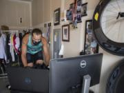 Joshua Monda demonstrates how he virtually rides his bike through London in the garage of his Vancouver home Wednesday afternoon, July 22, 2020.