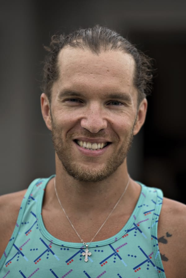 Local triathlete Joshua Monda pauses for a photo outside his Vancouver home Wednesday afternoon, July 22, 2020. (Amanda Cowan/The Columbian)