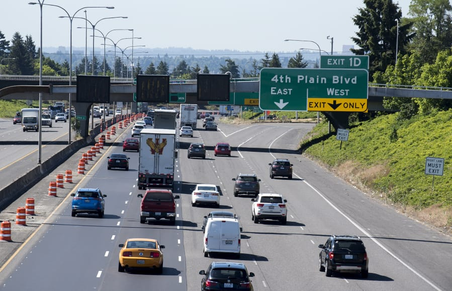Motorists travel southbound on Interstate 5 through Vancouver as they pass speed advisory signs installed as part of a project to improve traffic management on the freeway through Vancouver. The project is timed to be completed ahead of a planned I-5 Bridge maintenance project in September, which will close the northbound span of the I-5 Bridge for nine days and is expected to cause significant congestion.