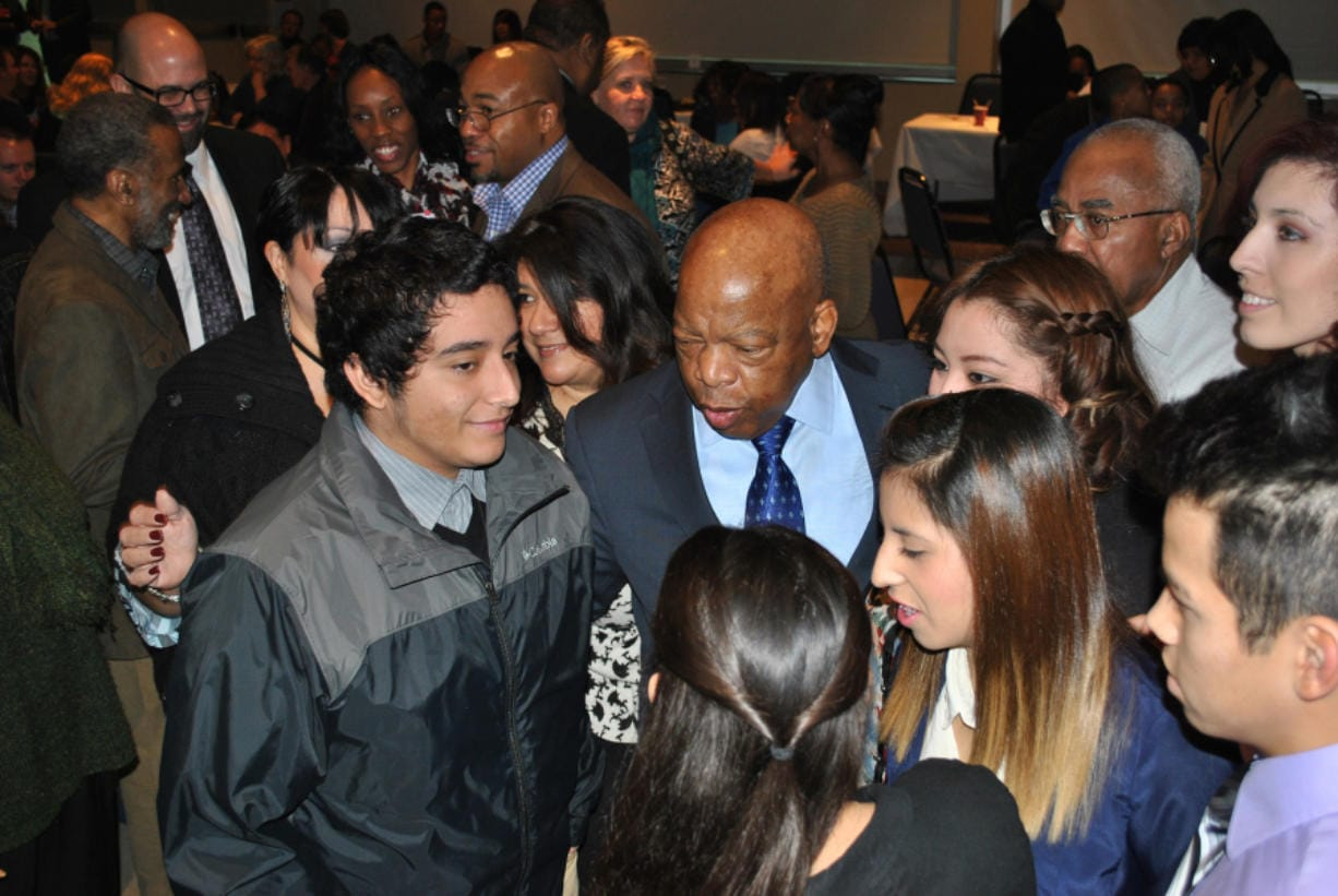 U.S. Rep. John Lewis, the civil rights icon, was a surprise special guest at the 2014 Martin Luther King Jr. Breakfast at Clark College. Here he greets youths with the local League of United Latin American Citizens.
