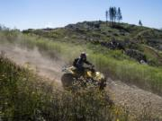 Jess Shutts of Vancouver rides an ATV on Saturday in the Jones Creek Trail System in the Yacolt Burn State Forest.