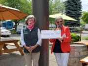 BAGLEY DOWNS: Becky O'Donnell, president of the Clark County Newcomers Club, donates a check for $4,748.52 to Gail Czech, president of Friends of Hospice.